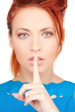 bright picture of young woman with finger on lips Stock Photo - 6760547