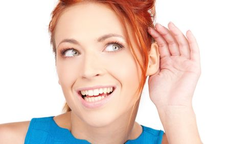 bright picture of young woman listening gossip Stock Photo - 6760595