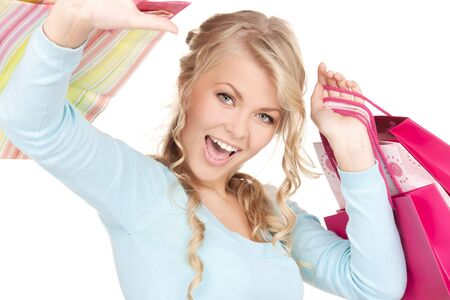 happy woman with shopping bags over white Stock Photo - 6760617