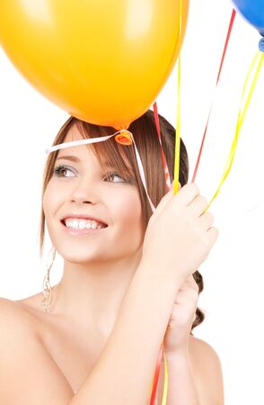 happy teenage girl with balloons over white photo