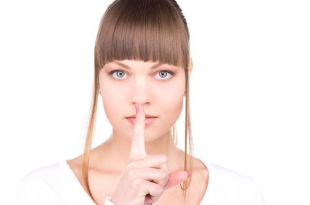 bright picture of young woman with finger on lips Stock Photo - 6760716