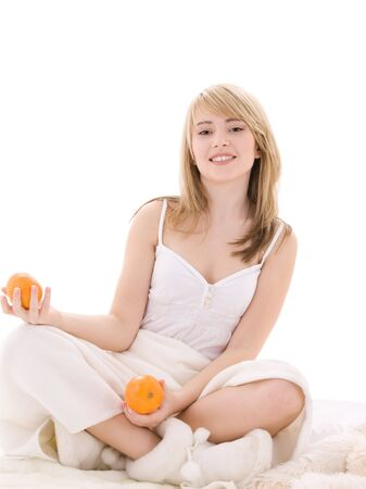 bright picture of lovely blonde with oranges Stock Photo - 6760642