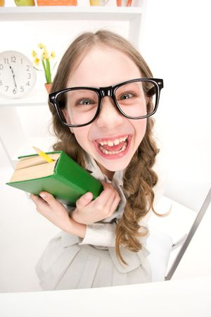 funny glasses: wideangle distorted picture of funny girl with green book
