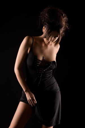 dark picture of sexy woman in black dress Stock Photo - 6805682