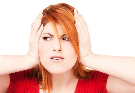 picture of unhappy redhead woman with hands on ears Stock Photo - 6805680