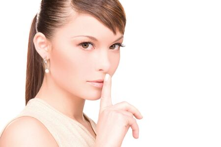 bright picture of young woman with finger on lips Stock Photo - 6805663