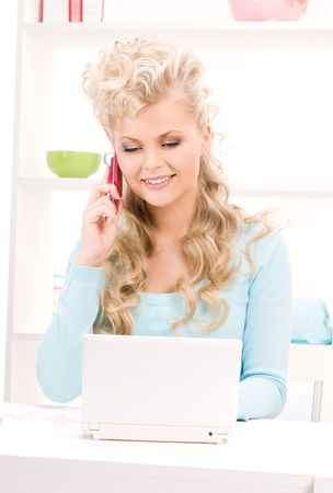 picture of lovely woman with cell phone and computer photo