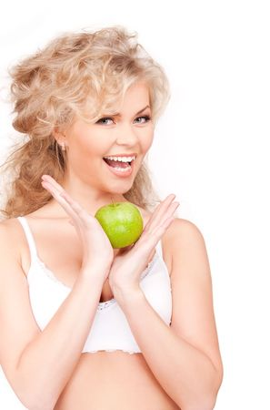picture of young beautiful woman with green apple photo