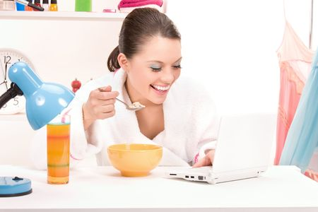 picture of eating woman with laptop computer photo