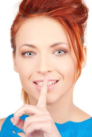 bright picture of young woman with finger on lips Stock Photo - 6805789
