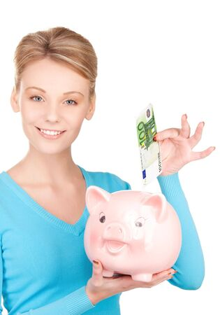 picture of lovely woman with piggy bank and money Stock Photo - 6805785