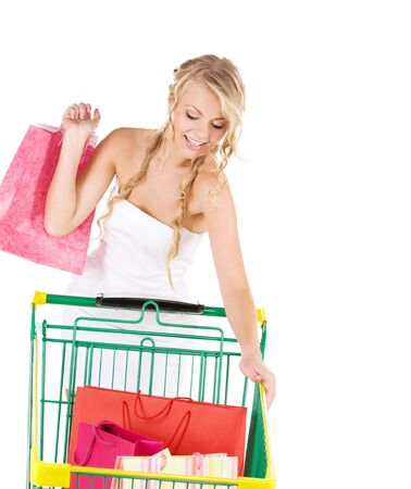 happy woman with shopping bags and cart over white Stock Photo - 6805797
