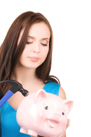 lovely teenage girl with piggy bank and hammer Stock Photo - 6805750