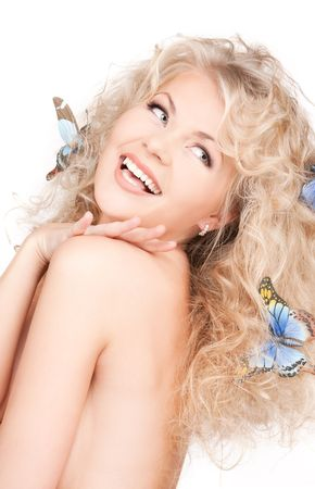 picture of happy woman with butterflies in hair photo