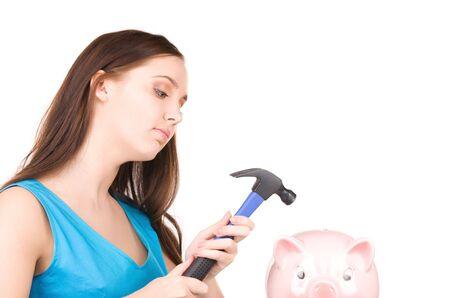 lovely teenage girl with piggy bank and hammer Stock Photo - 6805976