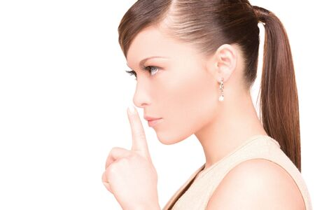 bright picture of young woman with finger on lips Stock Photo - 6806036