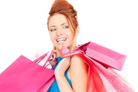 happy woman with shopping bags over white photo