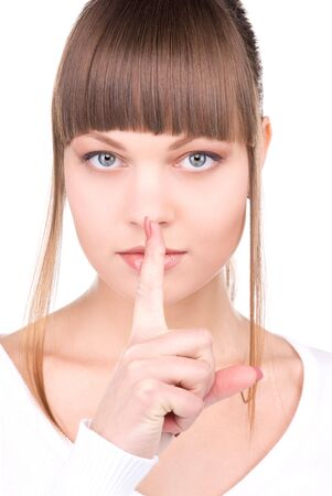 bright picture of young woman with finger on lips Stock Photo - 6806192
