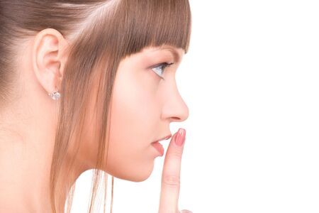 bright picture of young woman with finger on lips Stock Photo - 6806168