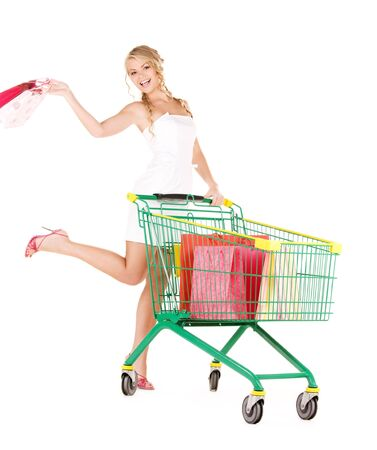 happy woman with shopping cart over white Stock Photo - 6806081