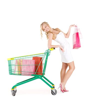 happy woman with shopping bags and cart over white Stock Photo - 6806315