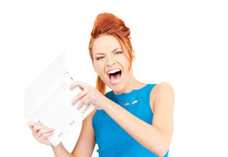 picture of angry woman with laptop computer photo