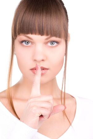 bright picture of young woman with finger on lips Stock Photo - 6858144