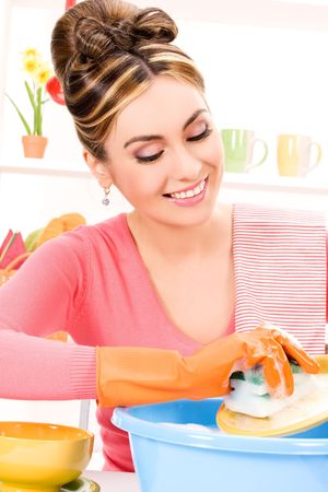 picture of beautiful housewife washing dish at the kitchen Stock Photo - 6858164