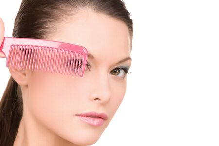 bright picture of beautiful woman with comb (focus on brush) Stock Photo - 6858165