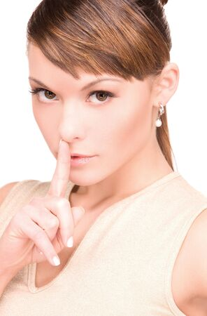 bright picture of young woman with finger on lips Stock Photo - 6850315
