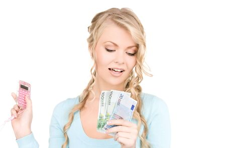 happy woman with calculator and money over white photo
