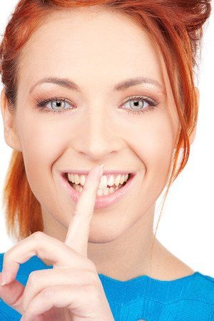 bright picture of young woman with finger on lips Stock Photo - 6861583
