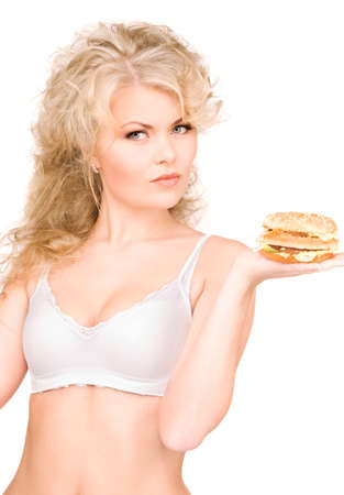 young beautiful woman with burger over white Stock Photo - 6861562