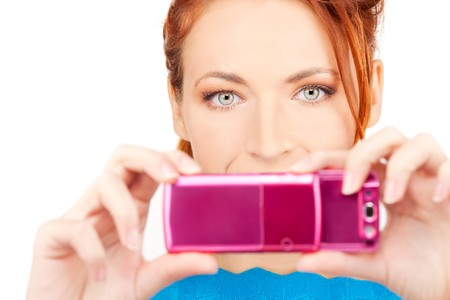 picture of happy woman using phone camera Stock Photo - 6861581