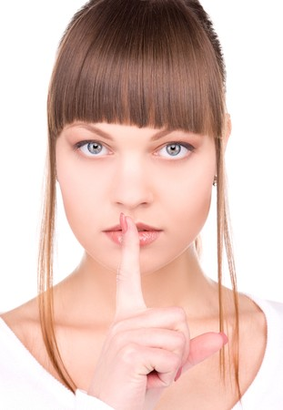 bright picture of young woman with finger on lips Stock Photo - 6862151