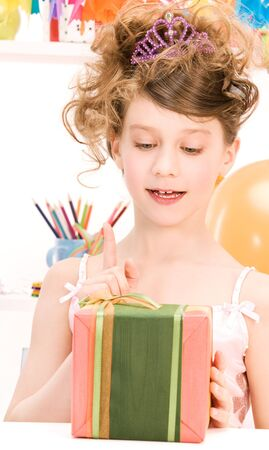 happy party girl with balloons and gift box photo