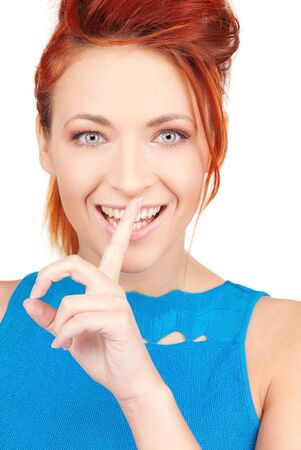 bright picture of young woman with finger on lips Stock Photo - 6862146