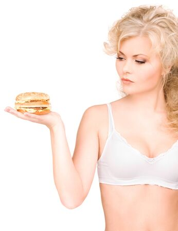 young beautiful woman with burger over white Stock Photo - 6862118