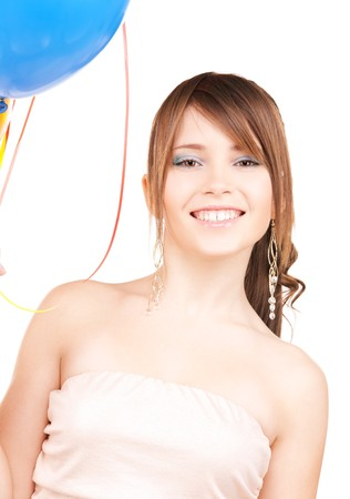 happy teenage girl with balloons over white Stock Photo - 6941657