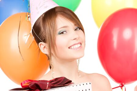 happy teenage party girl with balloons and gift box Stock Photo - 6941783