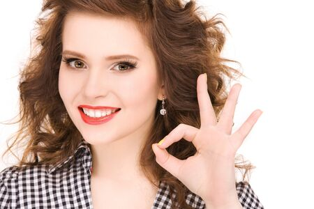 bright picture of lovely woman showing ok sign Stock Photo - 6941878