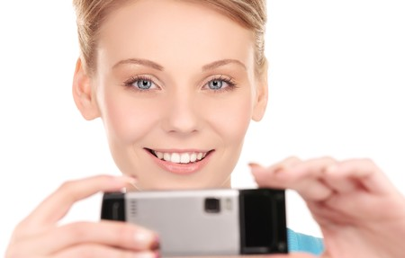 picture of happy woman using phone camera Stock Photo - 6941690