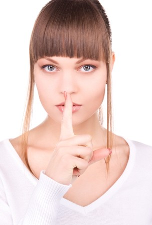 bright picture of young woman with finger on lips Stock Photo - 6942132