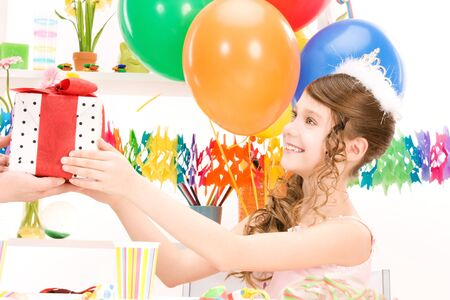 happy party girl with balloons and gift box Stock Photo - 6942658