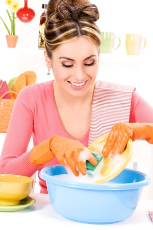 dish washing gloves: picture of beautiful housewife washing dish at the kitchen