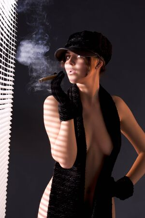 sexy woman in black astrakhan smoking cigar Stock Photo - 6942312