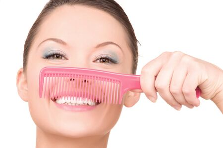 bright picture of beautiful woman with comb Stock Photo - 6941925