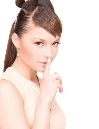 bright picture of young woman with finger on lips Stock Photo - 6942313