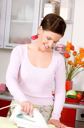 picture of ironing woman in the kitchen Stock Photo - 16619184