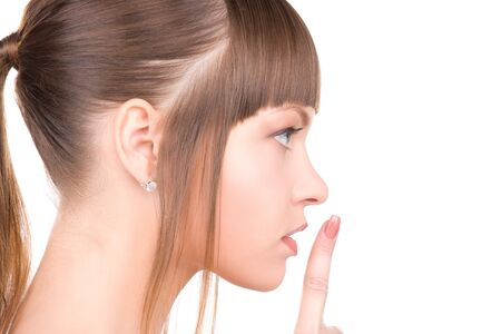 bright picture of young woman with finger on lips Stock Photo - 6942690